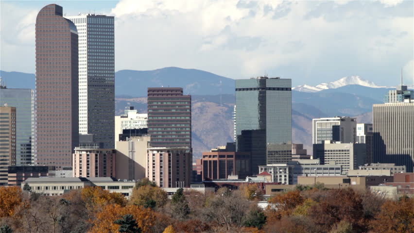 Slow zoom-out of the Denver, Colorado skyline, with City Park in the foreground.