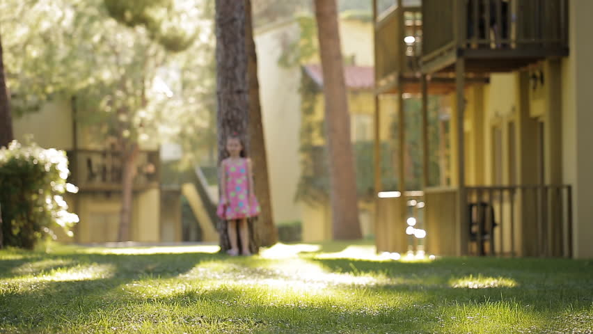 Girl jumping, dancing, spinning in an oak alley. The wind blew her hair and dress. Bright and sunny picture. Hair is covering the face.Fain art film. | Shutterstock HD Video #28964896