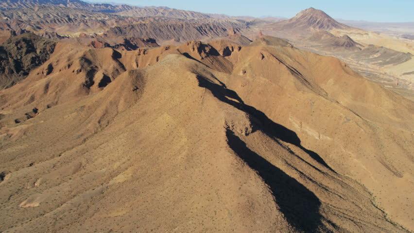 Aerial view Rock Canyon mountain range near Las Vegas deep valleys extreme terrain Nevada USA RED EPIC | Shutterstock HD Video #29009302