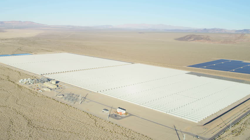 Aerial view Solar Panels harvesting outdoor clean energy from the sun Las Vegas desert Nevada USA RED EPIC | Shutterstock HD Video #29009329