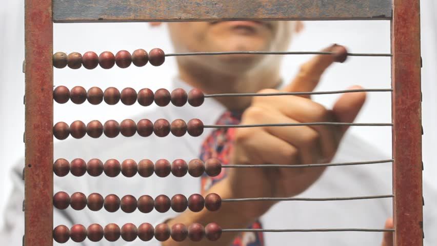 out of focus man and old abacus - HD stock video clip