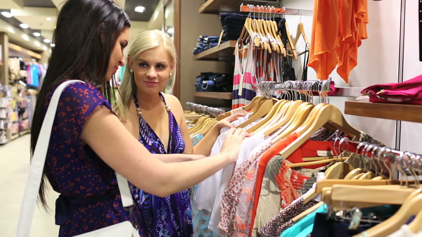 Friends happily shopping together in clothing store - HD stock footage clip