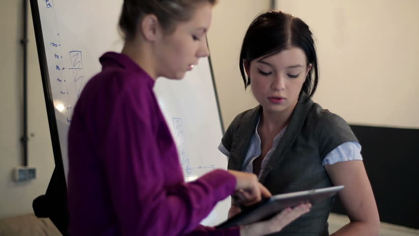 Young businesswoman working on tablet computer in the boardroom   - HD stock footage clip