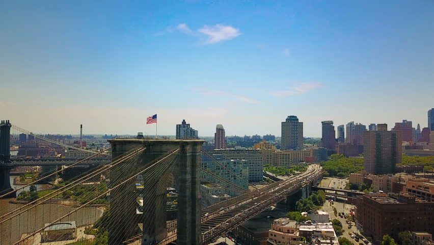 Aerial drone view of New York Brooklyn Bridge and the Hudson River, close up view a flag | Shutterstock HD Video #29109931