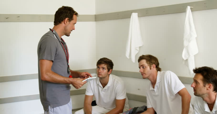 Coach interacting with cricket players in dressing room | Shutterstock HD Video #29209444