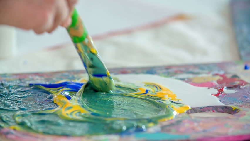 Kids are using tempera colours in their art class and they are making some beautiful paintings. | Shutterstock HD Video #29215510