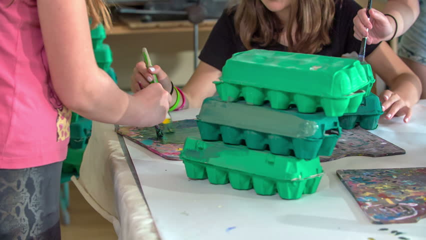 A few school children are colouring egg cartons green. they are having fun in their art class. | Shutterstock HD Video #29215519