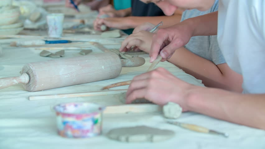 Students are having their art class and they are enjoying making something from clay and colour egg cartons. | Shutterstock HD Video #29215537