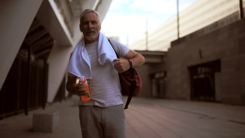 Smiling senior man walking after sport exercises | Shutterstock HD Video #29227336
