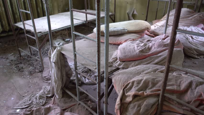 Kopani village, Chernobyl, Ukraine - 17th of June 2017: Visit to Chernobyl exclusion zone - 4K Beds and linens in abandoned nursery at the Chernobyl zone  | Shutterstock HD Video #29231107