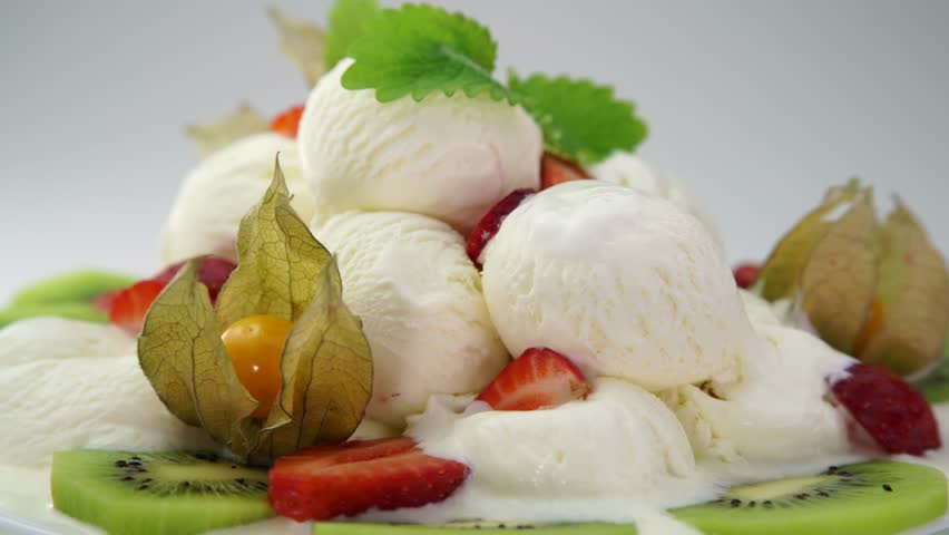 Ice cream dessert with strawberry and kiwi fruits on a plate. 360 rotation food #29260645
