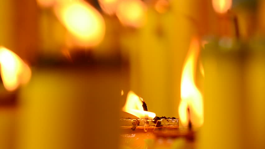 Golden light of candle flame in Chinese Vegetarian Festival | Shutterstock HD Video #2928544
