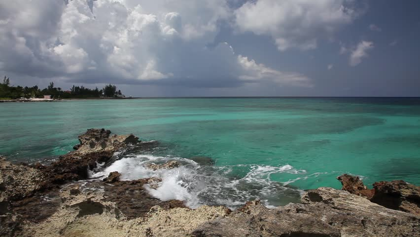 Gentle Caribbean sea waves touching rocks, Grand Cayman. Ambient sound.