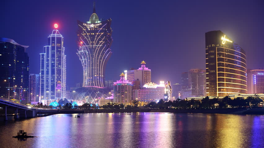 MACAU - OCTOBER 12: Skyline of resort casinos at Nam Van Lake October 12, 2012 in Macau, China. The city maintains the world's highest gambling revenue with over 20 million tourists annually.