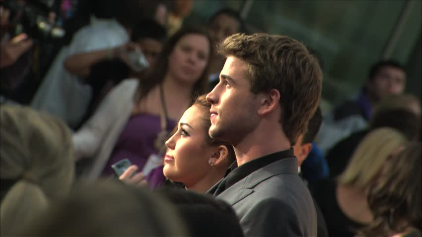 Hollywood, CA - MARCH 25, 2010: Miley Cyrus,Liam Hemsworth walks the red carpet at the The Last Song Premiere held at the ArcLight Cinemas - HD stock video clip