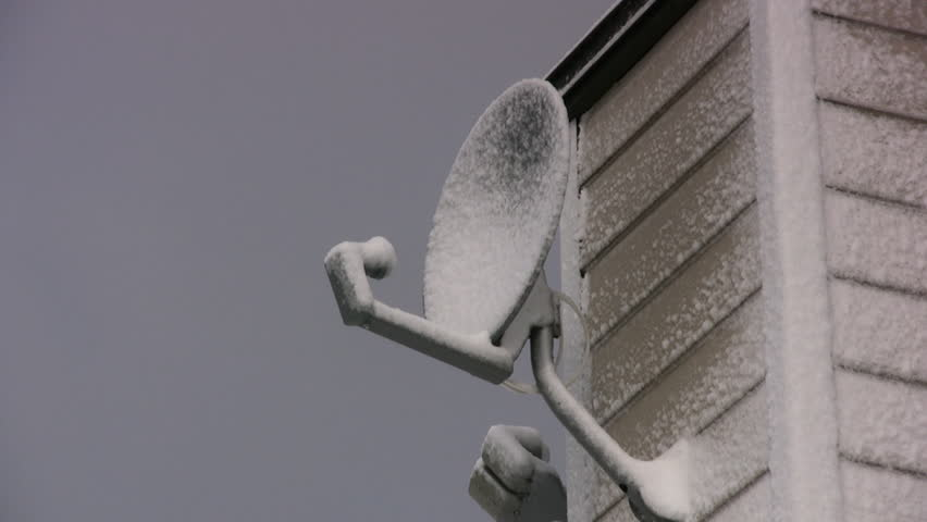 Satellite Dish On A House Covered In Snow - HD stock video clip
