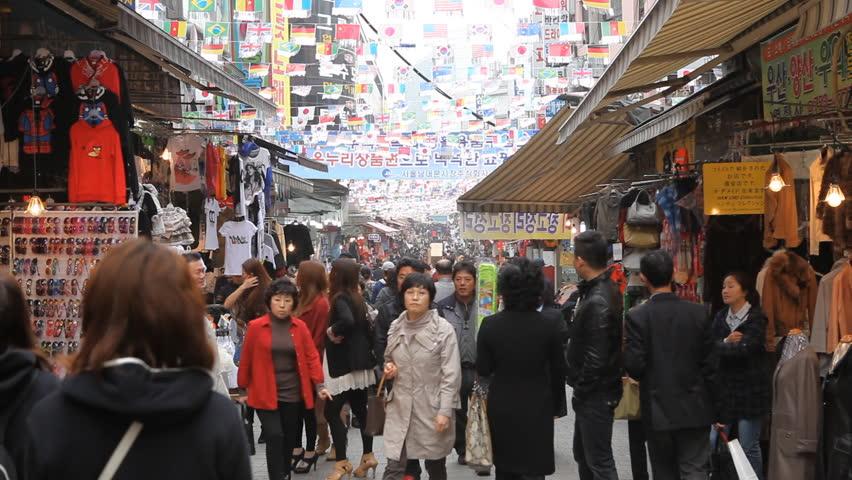 SEOUL, SOUTH KOREA - APRIL 22, 2012 Cheap Clothes Sales, Asian Shopping, Seoul Market Street, Shoppers, South Korea