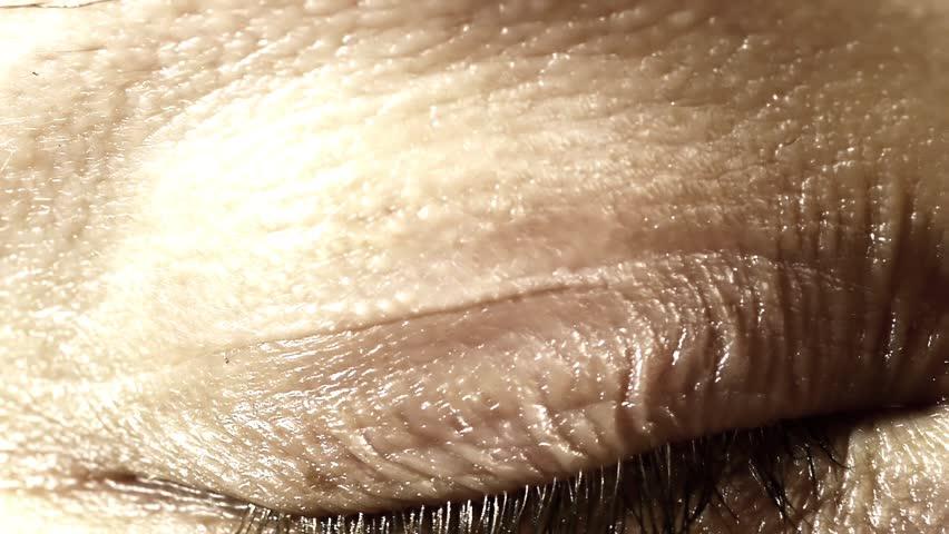 Neuronal Activity Female Blue Zooming through a female eye into the brain