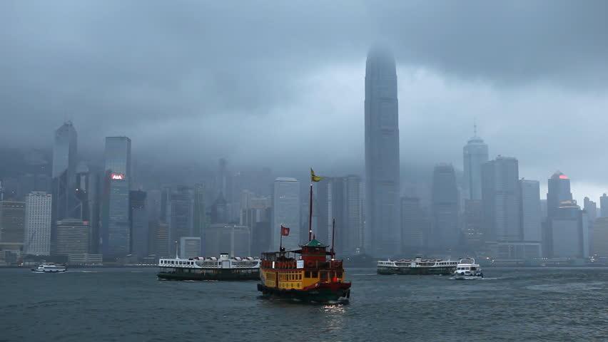 HONG KONG - MAY 19, 2012 Mansoon Season in  Hong Kong, Victoria Harbour, Kowloon, Ship, Skyscrapers | Shutterstock HD Video #2970538