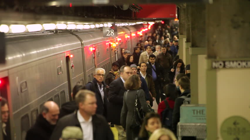 NEW YORK - CIRCA, November 2012: Crowd of commuters getting off train at Grand Central station Slow Motion