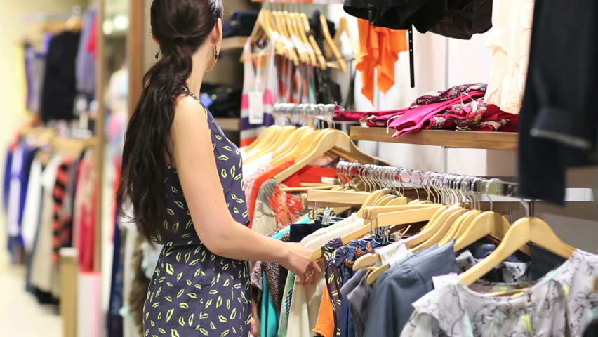 Woman shoplifting in clothing store - HD stock footage clip