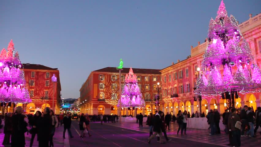 NICE DECEMBER 20, 2011. Christmas market in Place Massena on December 20, 2011 in Nice, France. The square is decorated every year includes activities like ice skating and a giant ferris wheel. - HD stock video clip