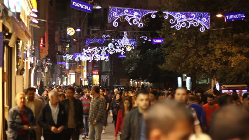 ISTANBUL - NOVEMBER 3 : People walk through the street at night on November 3, 2012 in Istanbul, Turkey. - HD stock footage clip