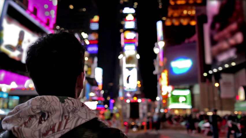 Male Tourist in Times Square Takes Smartphone Picture - Manhattan New York City NYC USA