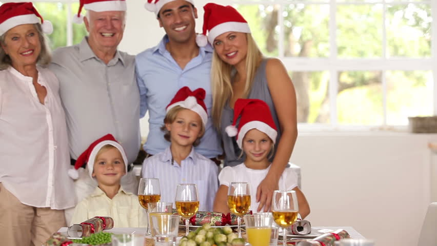 Happy family posing for photograph at christmas time