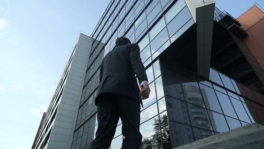 Businessman climbing stairs to the business center