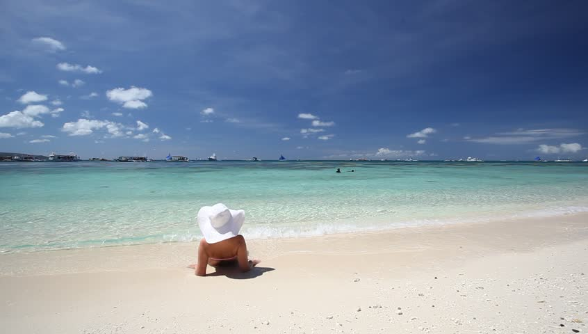 Caribbean Relaxation: Woman In Sun Hat Relaxing On Caribbean Beach Stock Footage
