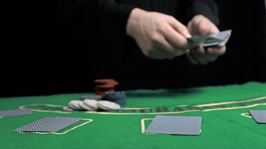 Man dealing the cards in slow motion on a gambling table