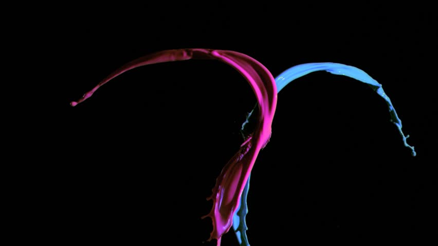 Blue and pink paint in super slow motion being thrown against a black background - HD stock footage clip