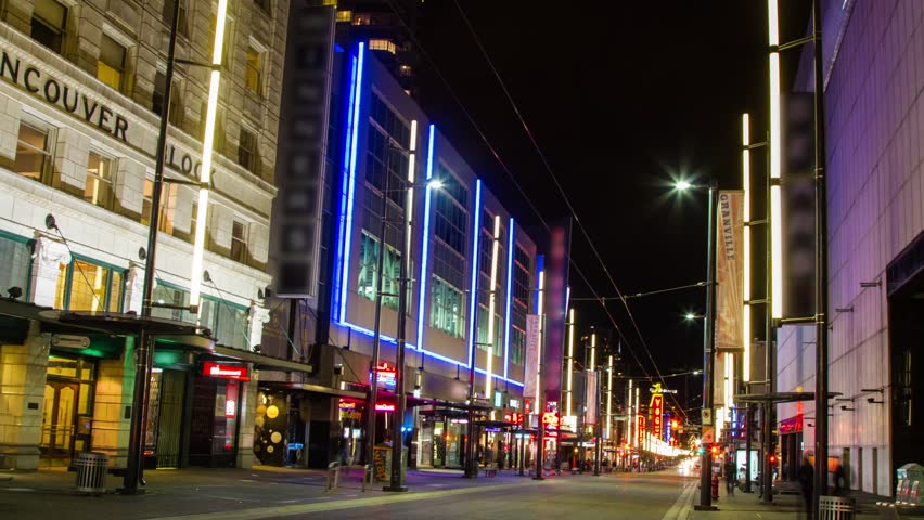 VANCOUVER - CIRCA 2012: Time lapse of Granville Street, one of the busiest streets in Downtown Vancouver, Canada circa 2012. People and cars non-stop moving up and down the street