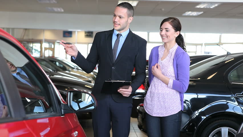 Businessman showing a car in a dealership