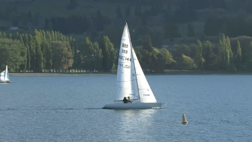 Clear Lake (SD) United States  city photos : : Small Yacht With Colourful Sails Sailing On Lake Wanaka On A Clear ...