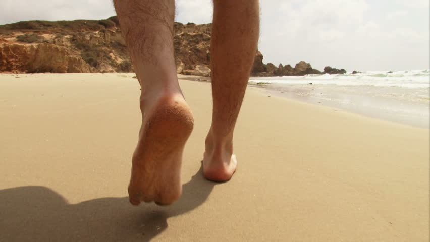 CU guy's feet walking on beach - HD stock video clip