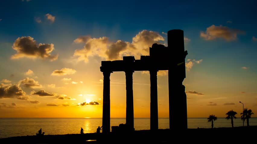 Sunset against the backdrop of ancient ruins