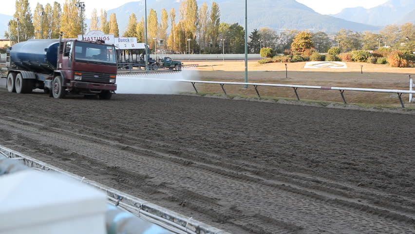 VANCOUVER, BC  OCTOBER 8th: Water truck prepares the track at Hastings Racecourse on Oct 8th, 2012 in Vancouver, BC, Canada.  Hastings Racecourse is four miles from downtown Vancouver, BC, Canada. - HD stock video clip