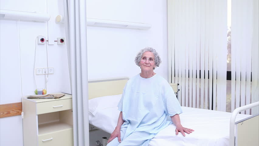 Nurse holding the hand of a patient in hospital ward - HD stock video clip