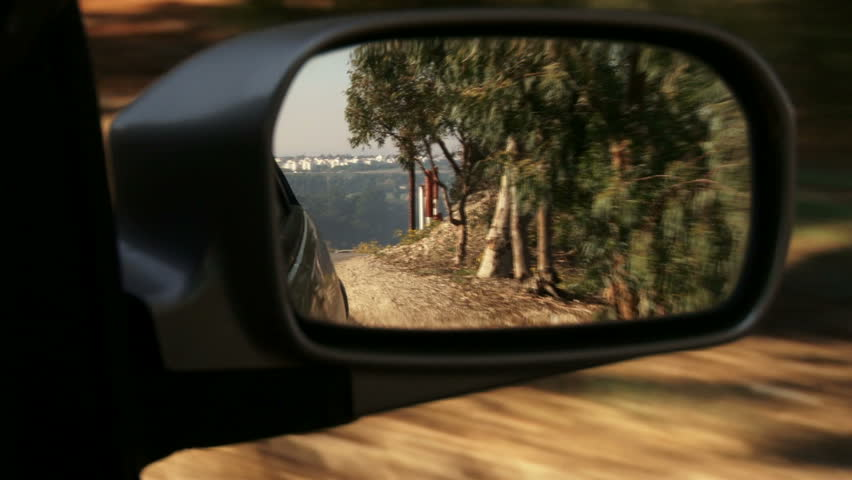 Right car mirror POV. Driving on a sunny day, trees. - HD stock video clip