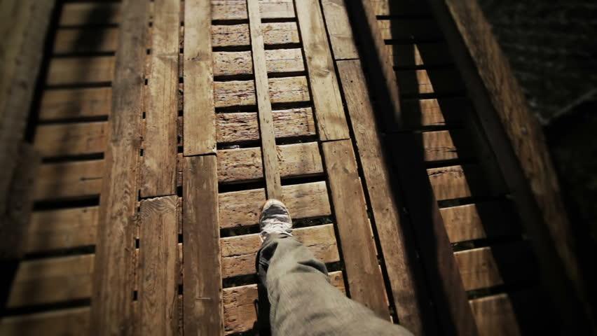 Man Walking on a footbridge  | Shutterstock HD Video #3054508
