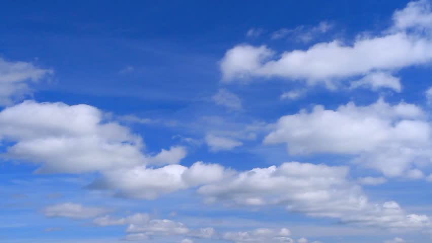 White clouds flying on blue sky. Time lapse.