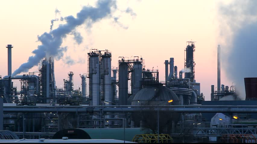 Oil and gas refinery at twilight - factory smoke stack  - Time lapse - HD stock footage clip
