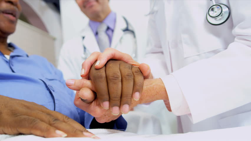 Medical Consultants Reassuring Patient