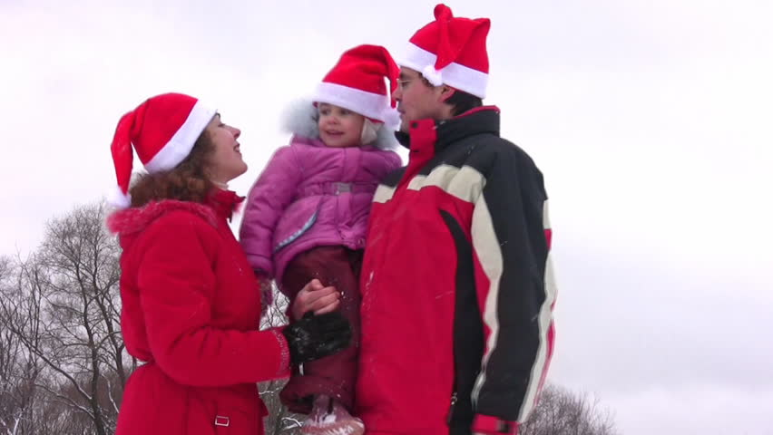 family with little girl, faces  - HD stock video clip