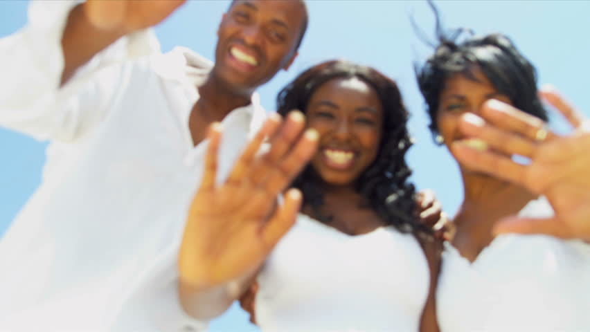 Smiling African American family have fun together on beach | Shutterstock HD Video #3085666