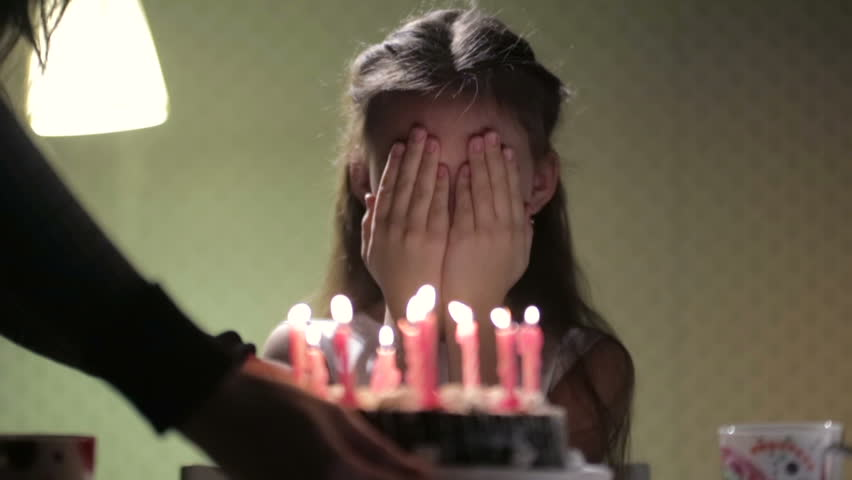 Birthday girl and cake with candles - HD stock video clip
