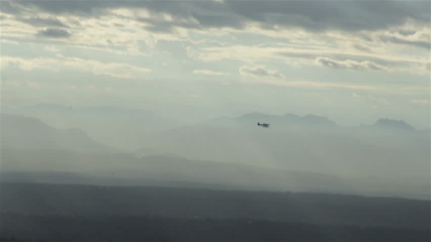 View from airplane of float plane silhouette flying in front of mountain range - HD stock footage clip
