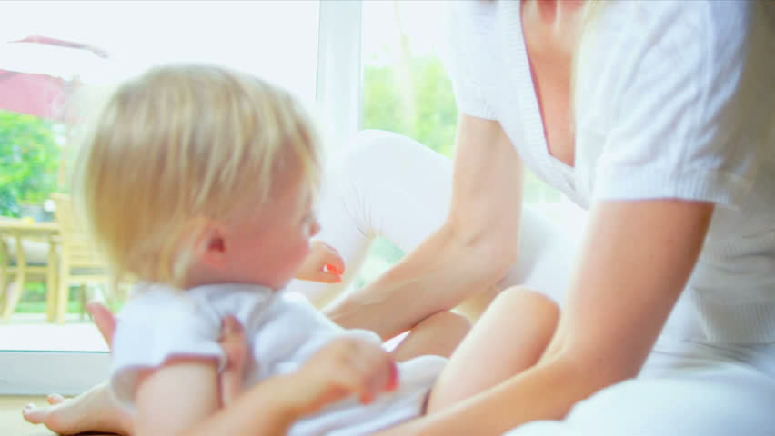 Beautiful Young Mom Child Playing on Floor - HD stock footage clip
